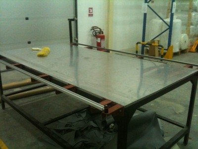 """AIS Custom table with removable """"wing"""" supports so the table can be placed in a shipping container."""