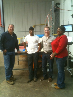 Boss man Robin Goodwin and operator's Cory and Peggy take a final picture with Tom before saying goodbye.  Install and training success!