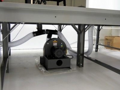 Level vacuum table with flexible plumbing attached to a 3HP, 3phase blower