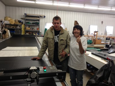 Joe and Marie with their new CTx-72 plotter/cutter and 28' long Phillocraft vac table