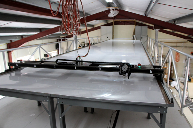 The loft is big enough for a 7'x32' plotter/cutter system and vacuum table.  They are also keeping all valuable hardware up here in locked cabinets.  If you aren't running the cutter you shouldn't be up here!