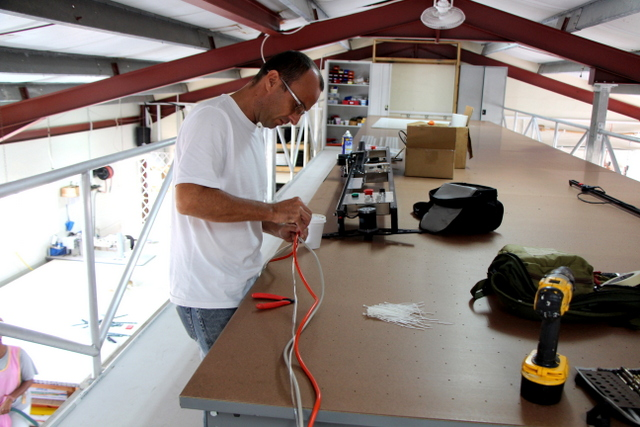 Paul is helping zip-tie the control, air, and power cables together.