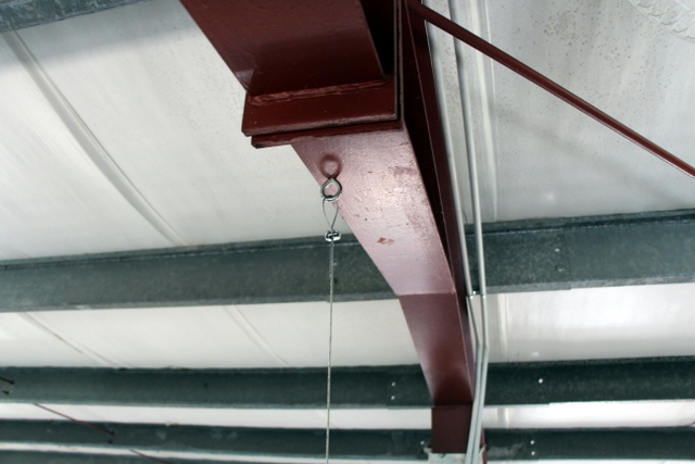 """Over-head cabling eye hook and 3/32"""" cable."""