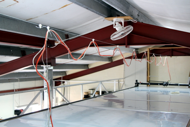 The over head cabling runs on high quality Harken pulleys.  You can also side-mount your cabling OR run it in a cat-track.