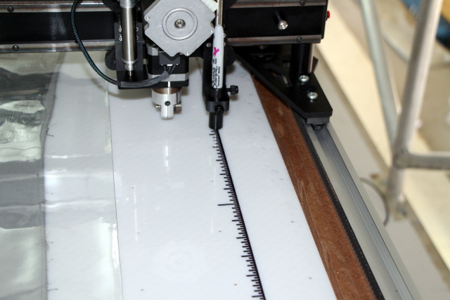 Add a measuring tape and alignment mark to the edge of the table to make it easier to align your material.