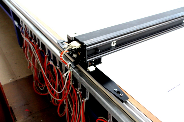 Use enough slides to keep the cable off the floor.  A Bungee Cord from the first slide to the cutter will prevent putting undo stress on the control and power cable.