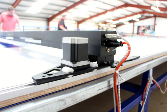 The Plotter/Cutter is driven by three cables: air, power, and control.
