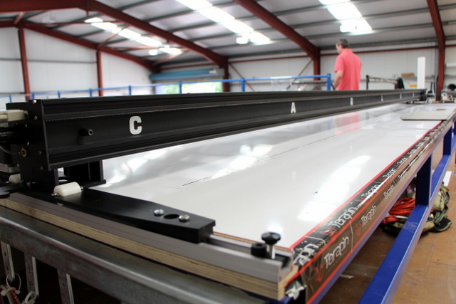 """4""""x4"""" composite aluminum frame keeps the machine rigid at 172"""" wide.  Stretched X drive plates keep it square on a 58' long table."""