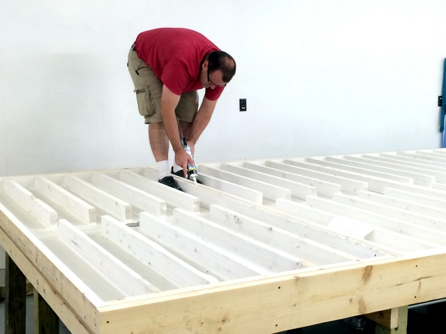 Todd puts the final touches on their home built table, caulking the seams.  They built a large plenum, with plans to make their cutting surface the top of the table.  This something that hasn't been tried before, but they can always change it late  if they want.