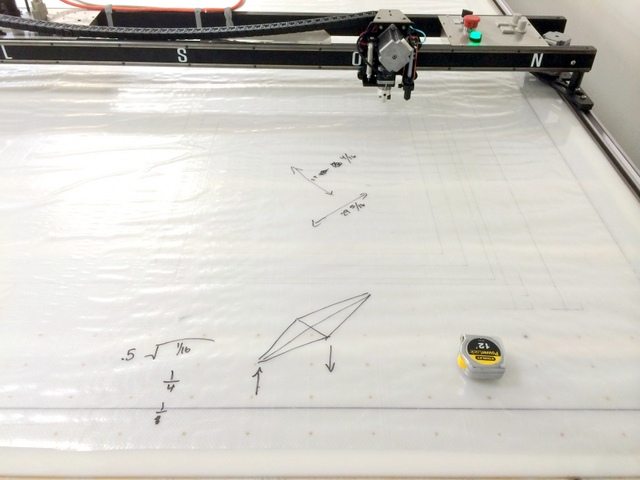 Once the plotter/cutter is calibrated, square the system to the track stops.