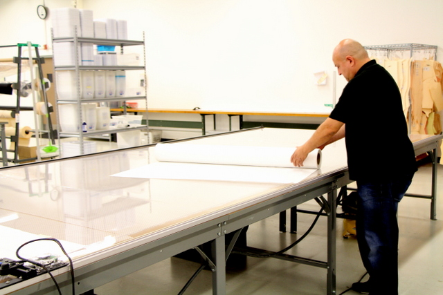 Initially, until the operator is comfortable digitizing, it is important to check digitized patterns match the original.  Jaime spreads patterning paper for our first test cut.