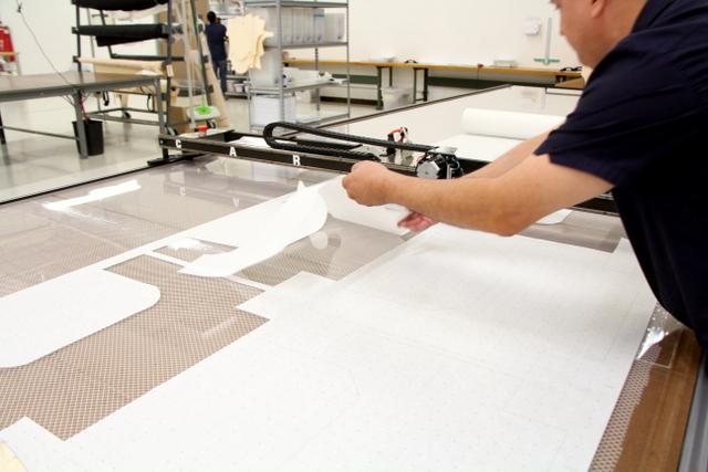 Cutting paper patterns.