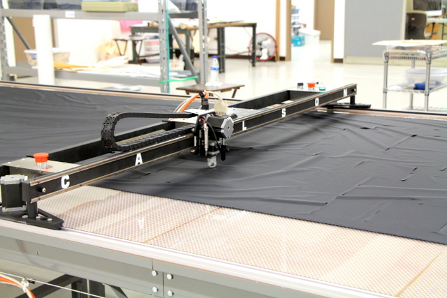 "PT-84"" Plotter/Cutter on a 7'x24' Phillocraft vacuum table, with a hard un-drilled acrylic cutting top."
