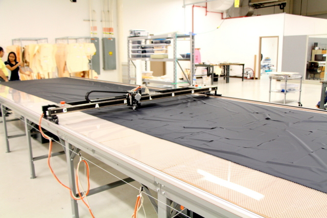 "PT-84"" Plotter/Cutter on a 24' long Phillocraft vacuum table."