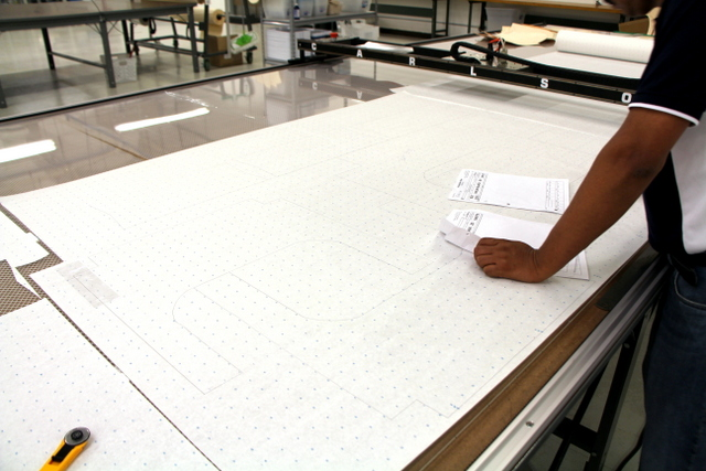 Patterns are traced onto pattern paper and manually nested.