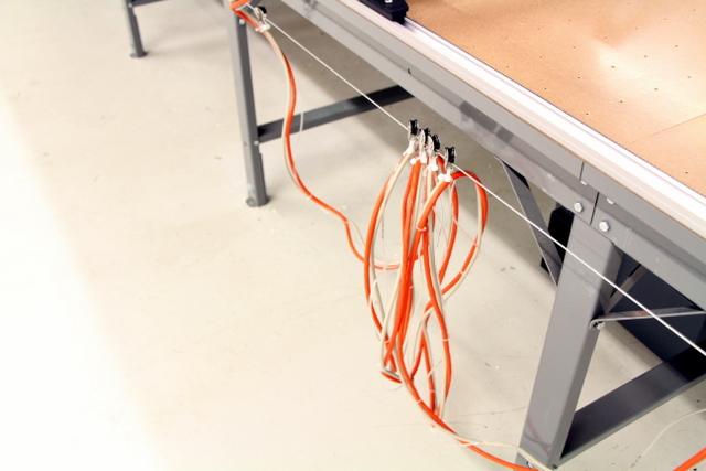 Zip tie cables to pulleys.