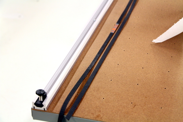 Thoroughly rub track belt with Acetone to remove grease before attaching to track.