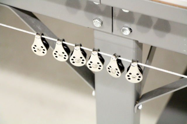 Use one pulley for every 4'-5' of table.  We recommend using high quality, sailing hardware.