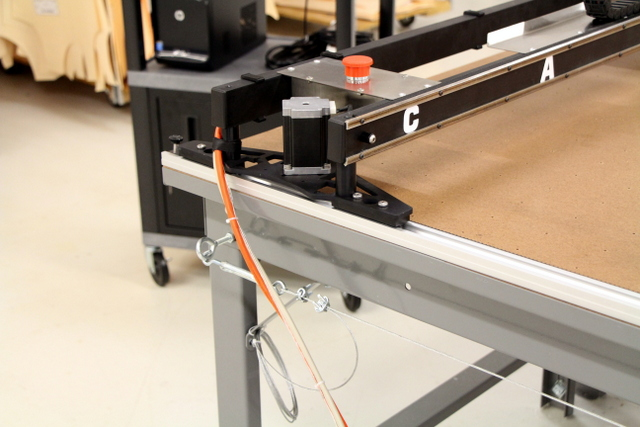 To determine cable drape, position the machine at the end of the table.  The cable should drape about 2'.