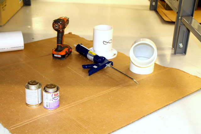 Attach plumbing to table.  Use silicone and #8 screws to attach flanges.  All vertically attached pieces are PVC glued.