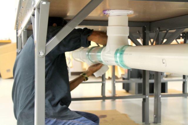 Horizontal plumbing is press fit and secured with stretch wrap.  This allows for easy reconfiguration later.