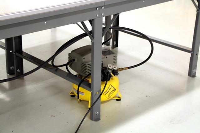 Connect the Plotter/Cutter to a source of compressed air (min 1CFM @ 90psi).  We recommend adding an oilier and water separator, especially  in high humidity environments.