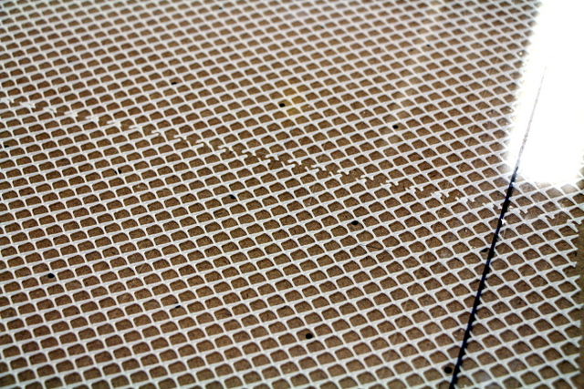 Vacuum breather mesh runs between the vacuum table and cutting surface.  This way, if they decide to convert to a vacuum, the surfaces vacuum holes do not need to align with the tables.