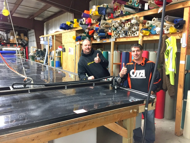 """Brian and Rick give a """"Thumbs Up"""" next to their PT-108"""" Plotter/Cutter"""