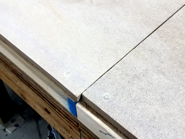We inspect all table seams and recommend several that would benefit from a little more smoothing and sanding.