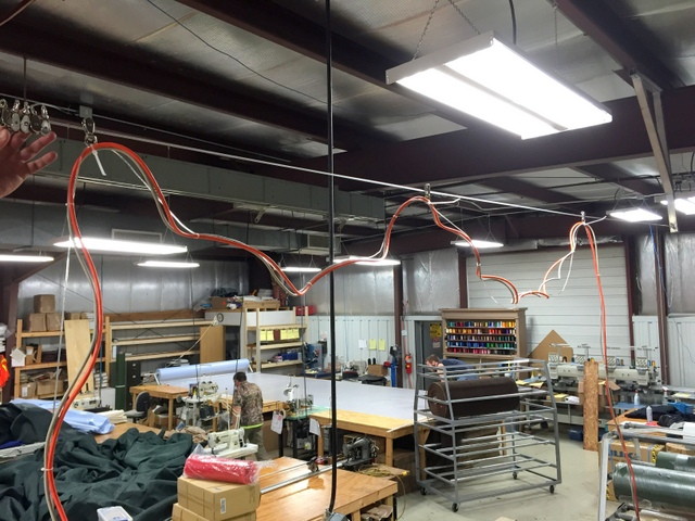 Hang control/air/power cable from pulleys.