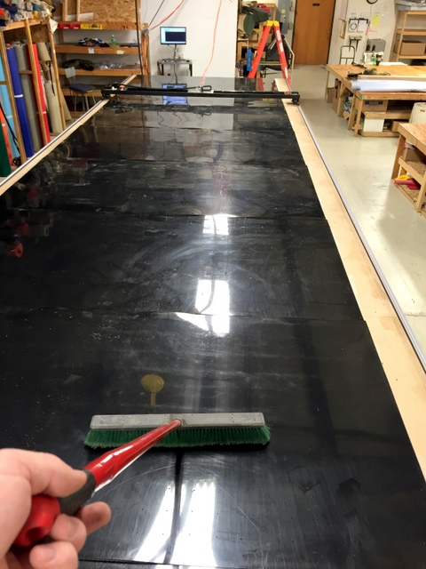 Sweep table to remove any debris from the install.  Wipe out the inside of both track sides.