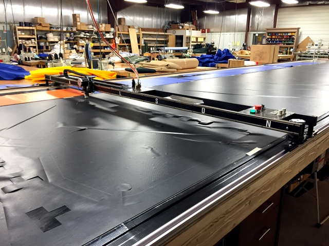 Next we nested all of the parts for a single cover and cut a cover out of 18oz vinyl using our carbide drag blade.