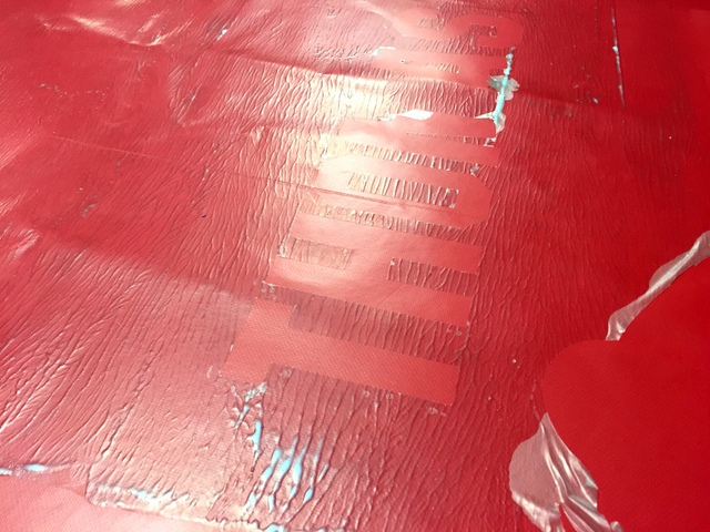 """Cut and peeled """"Thomas"""" out of the vinyl stencil goup.  The depth adjustable blade prevents cutting into the vinyl."""