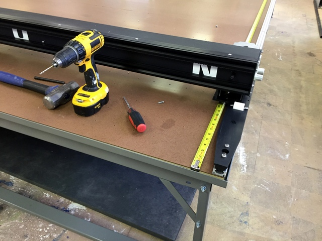 Gently set the Plotter/Cutter on the track and attach the Trolleys and load wheels.
