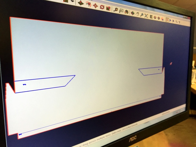 "This pad is designed specifically to be cut out of 126"" wide material.  It includes plot line (blue) and cut lines (red)."