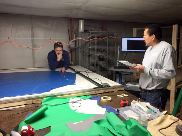Woody and Tony prepare to digitize a 20' long boat cover.