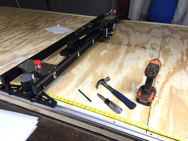 Use the Plotter/Cutter as a jig to attach side B.  Running a tape measure down both sides is a great way to ensure the machine remains square throughout the track installation.