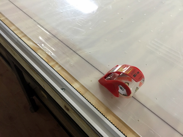 Once assembled, use the Plotter/Cutter to make a material alignment mark on the table.  Cover this mark with clear packing tape to prevent it from rubbing off.