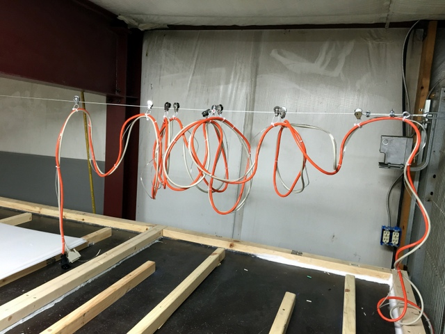 The low ceiling meant we had to double the number of pulleys used to keep the cabling above the Plotter/Cutter.