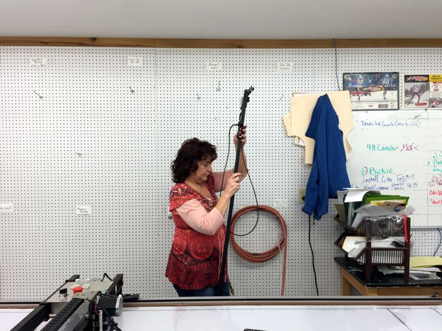 Malinda gets the T-Bar off the wall to digitize a new pattern set.