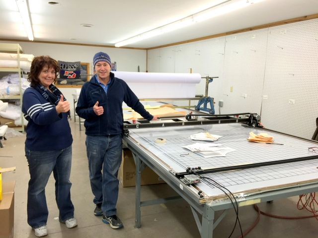 """VP Dan Rusch and operator Melinda give s big thumbs-up with their new PT-72"""" Plotter/Cutter."""