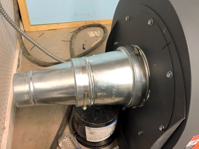 Connect reducers to blower housing.