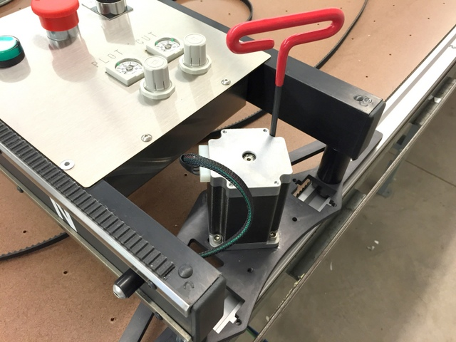 Once the Plotter/Cutter is installed, slide the X motors into the track belt so they are firmly engaged with minimal backlash.