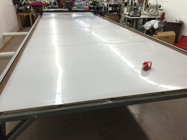 Use packing tape to attach the cutting surface to the table top.  Do not glue or screw the cutting surface to the table.  This may cause it to warp and in the future you will need to flip or change the cutting surface as it wears.