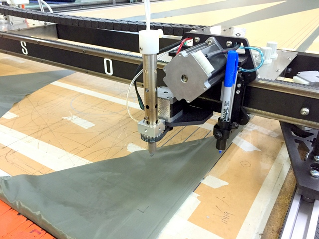40lb Butcher paper is used as a consumable cutting surface instead of a metal or plastic cutting surface.  Strong reports it is durable, they can use both sides, and they get better cuts than using a sheet metal top.