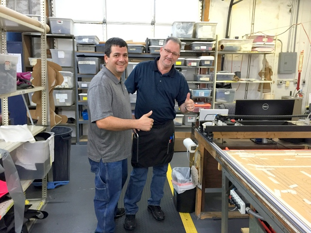 """Director Mike Rinaldi and operator Jim give a """"Thumbs up"""" next to their new PT-78"""" Plotter/Cutter."""