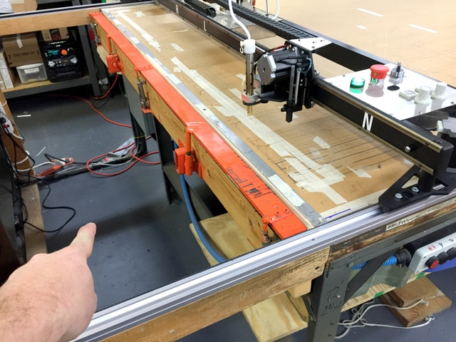 The extra track and open area is perfect for parking the hot knife in a safe area.  They also installed a pneumatic clamp to quickly hold the leading edge of their material.