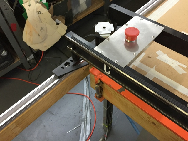 Slide the track carriages into side A and B and adjust them to glide smoothly down the track when vertically loaded.  Place the plotter/cutter gently on the track carriages.  Square the machine and then use the machine as a jig to keep the track square.