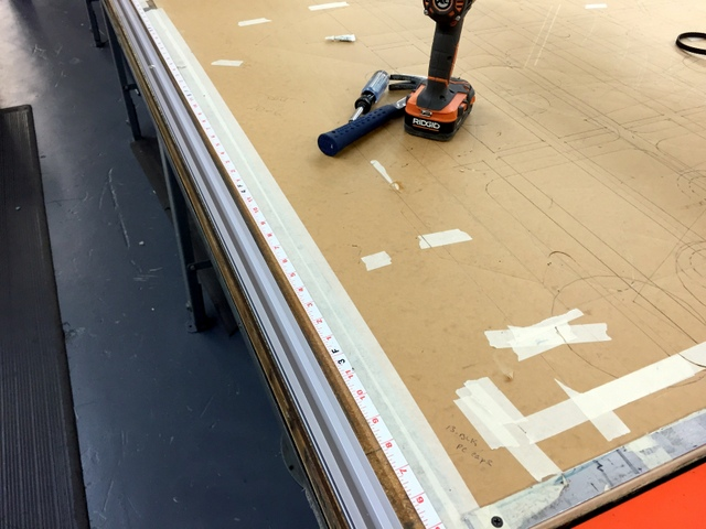 To keep the system square on a 78' long table, we recommend running a long tape down track side A and B.  Drill and screw the track to the table as you advance the Plotter/Cutter.