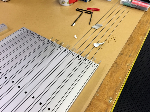 Loctite the track pins.  Loctite takes 10-15 minutes to setup, so it's best to do this step first.